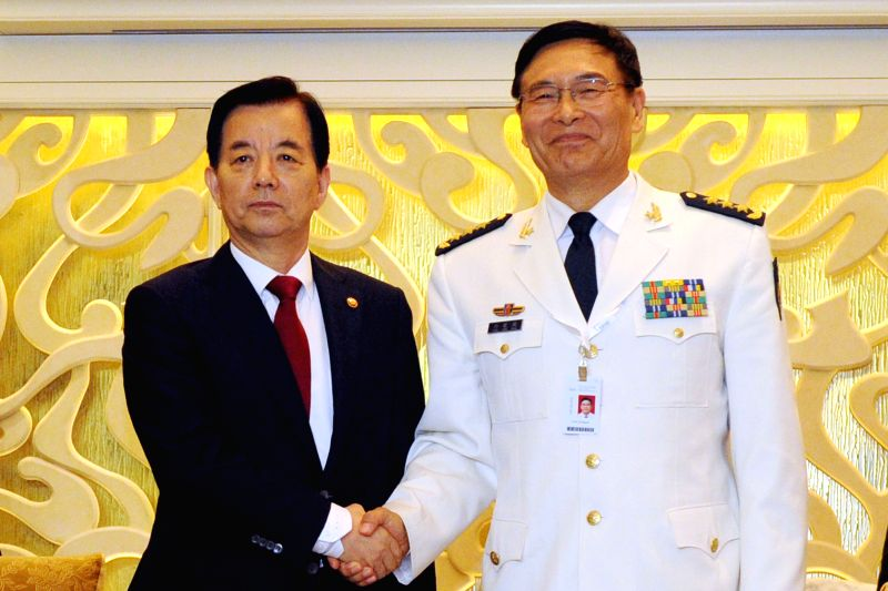 SINGAPORE, June 4, 2016 - Admiral Sun Jianguo (R), deputy chief of the Joint Staff Department of China's Central Military Commission, meets with South Korea's Minister of National Defense Han Minkoo ...