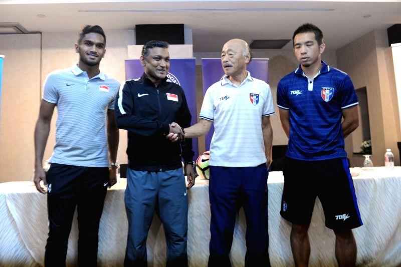 SINGAPORE, June 9, 2017 - Singapore's coach V Sundramoorthy (2nd L) and Singapore's team vice captain Hariss Harun (1st L), Chinese Taipei's coach Kuroda Kazuo (2nd R) and Chinese Taipei's captain ... - Hariss Harun