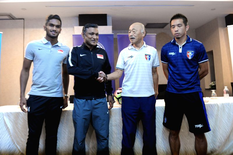 SINGAPORE, June 9, 2017 - Singapore's coach V Sundramoorthy (2nd L) and Singapore's team vice captain Hariss Harun (1st L), Chinese Taipei's coach Kuroda Kazuo (2nd R) and Chinese Taipei's captain ... - Hariss Harun