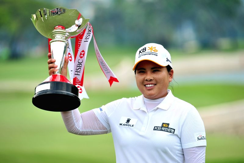 Inbee Park of South Korea poses with the trophy after winning the 2015 HSBC Women's Champions golf tournament at Singapore's Sentosa Golf Club Serapong Course, ...