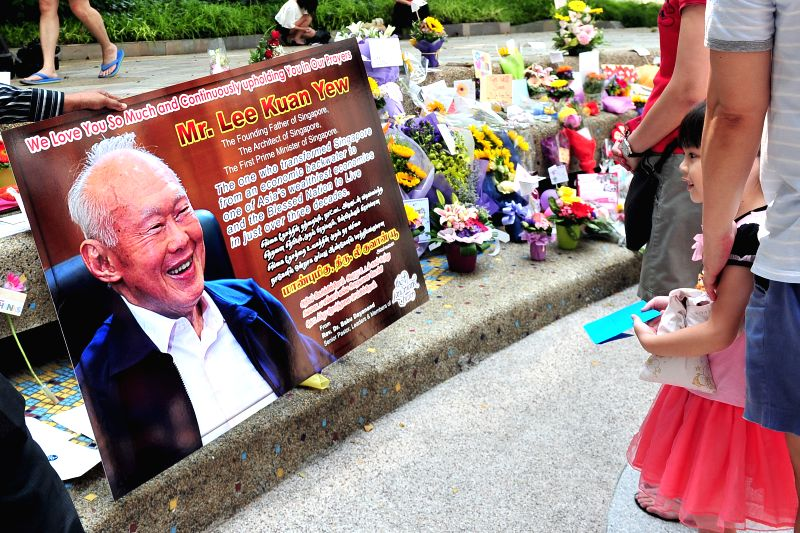 People lay flowers and well-wishing cards outside Block 7 of Singapore General Hospital, Singapore, March 21, 2015. Singapore's former Prime Minister Lee Kuan ...