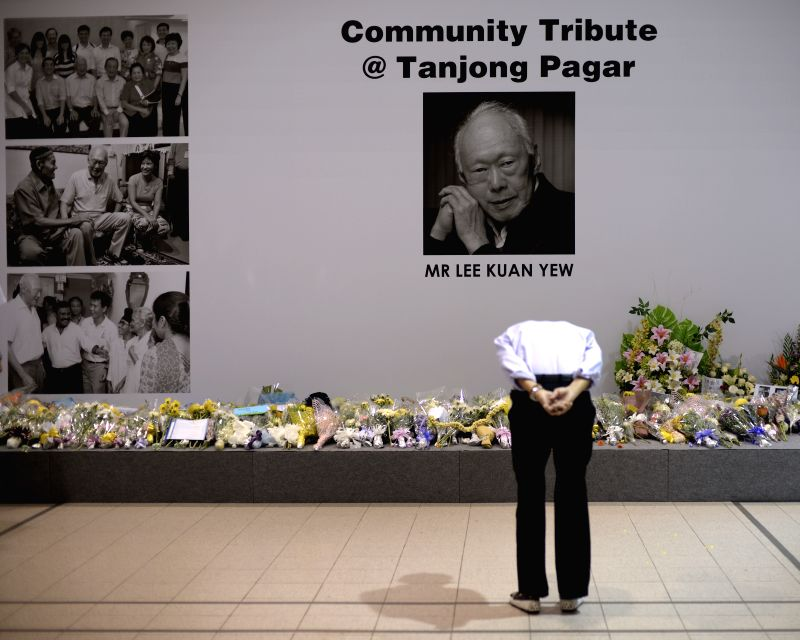 A man bows to the portrait of the late former Prime Minister Lee Kuan Yew at Singapore's Tanjong Pagar Community Club, March 23, 2015. Lee Kuan Yew died at 3:18 ...