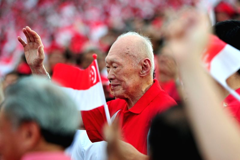 File photo taken on Aug. 9, 2013 shows Lee Kuan Yew attending the National Day Parade at the Float Marina Bay in Singapore. Singapore's Prime Minister Office ... - Office