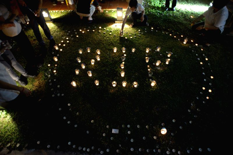 """Volunteers arrange the words """"RIP"""" as a tribute to the late former Prime Minister Lee Kuan Yew at Singapore's Tanjong Pagar Community Club, March 23, ..."""