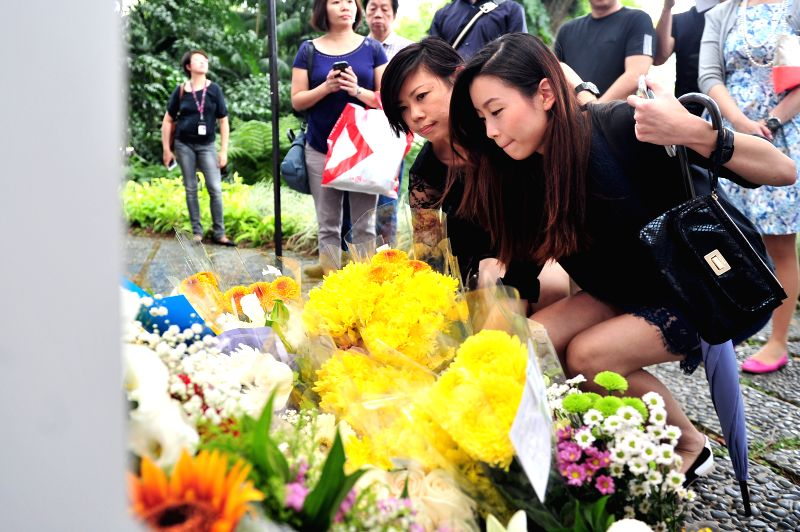 People lay flowers at the tribute zone for Lee Kuan Yew outside Singapore's Istana on March 24, 2015. Lee Kuan Yew, former prime minister of Singapore, died at ...
