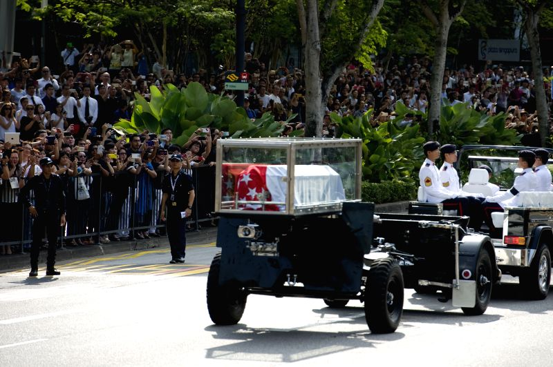 A military gun carriage conveying the coffin of Singapore's founding father Lee Kuan Yew leaves the Istana for Parliament House in Singapore, March 25, 2015. The ...