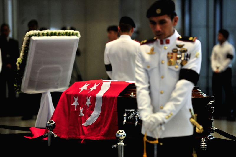 Vigil Guards stand on post around the casket of Singapore's former Prime Minister Lee Kuan Yew in Singapore's Parliament House, March 25, 2015. Singapore's ...