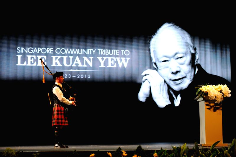 A bagpiper plays a tune during a memorial meeting of Singapore's founding father Lee Kuan Yew at Singapore's Kallang Theatre, March 27, 2015. Singapore's various ...