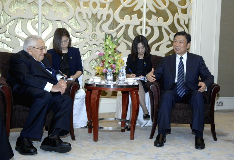Chinese Vice President Li Yuanchao (1st R) meets with former U.S. Secretary of State Henry Kissinger (1st L) in Singapore, March 29, 2015. (Xinhua/Ding ...