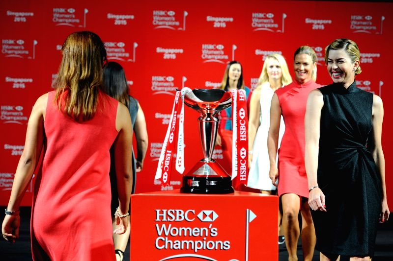 Paula Creamer (1st R) of the U.S. attends a pre-competition event of HSBC Women's Champions golf tournament in Singapore, March 3, 2015. HSBC Women's Champions ...