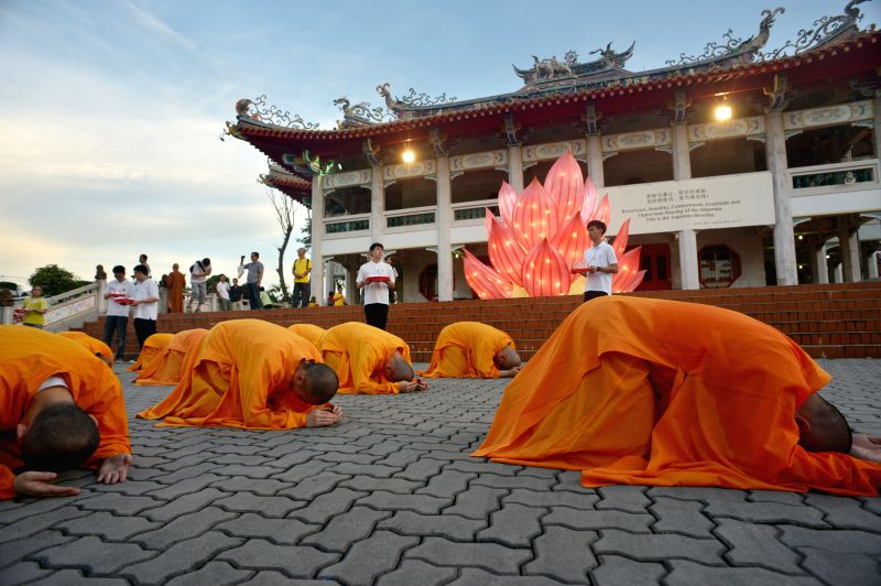 Monks attend the celebration on the eve of Vesak Day in Singapore, May 12, 2014. Vesak Day is a Buddhist holiday commemorating the birth, enlightenment and death ..