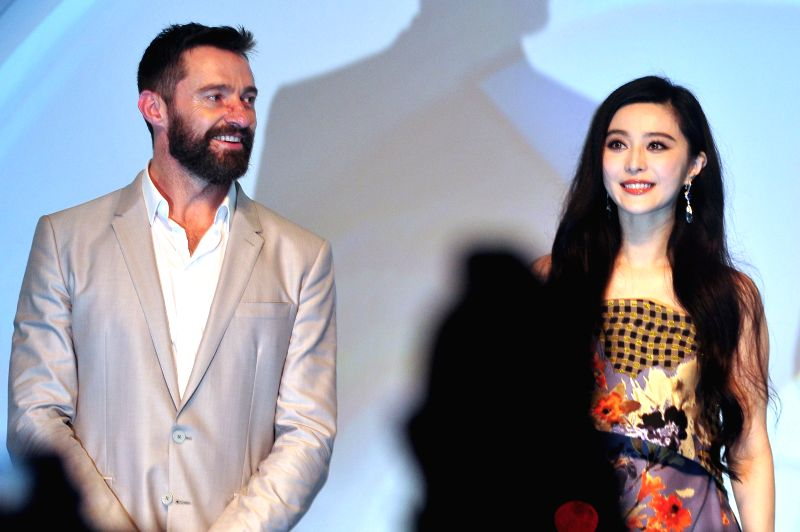 "Actor Hugh Jackman (L) and actress Fan Bingbing attend the ""Blue Carpet"" ceremony at the movie premiere of ""X-Men: Days of Future Past"" in ... - Hugh Jackman"