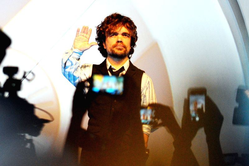 "Actor Peter Dinklage attends the ""Blue Carpet"" ceremony at the movie premiere of ""X-Men: Days of Future Past"" in Singapore on May 14, 2014. - Peter Dinklage"