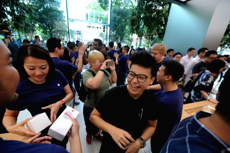 SINGAPORE, May 27, 2017 - Employees welcome visitors to the Apple Store at Singapore's Orchard Rd on May 27, 2017. The first Apple Store in southeast Asia opened in Singapore on Saturday.