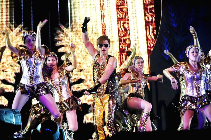 """Singer Show Lo (C) performs at his concert in Singapore Indoor Stadium on May 3, 2014. Show Lo held his concert """"Show Lo 2014 Over The Limit - Dance Soul ..."""