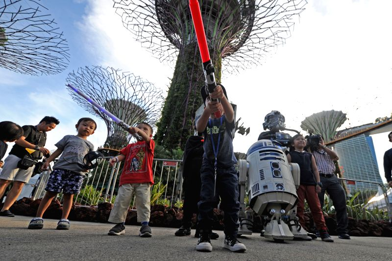 "SINGAPORE, May 4, 2017 - Star Wars fans attend the ""Star Wars Day: May the 4th Be with You Festival"" held in Singapore's Gardens by the Bay on May 4, 2017."