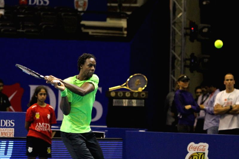 Micromax Indian Aces' Gael Monfils of France hits the ball in a match of the first International Premier Tennis League (IPTL) in Singapore, Dec. 2, 2014.