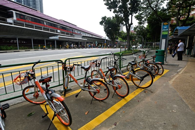 SINGAPORE, Oct. 16, 2017 - Photo taken on Oct. 16, 2017 shows shared bicycles parking inside of a drawn box in Singapore. Singapore's Land Transport Authority, National Parks Board and 16 Town ...