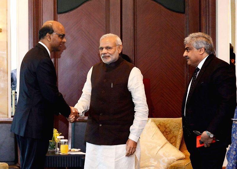 Singapore : Prime Minister Narendra Modi during a meeting with the Deputy Prime Minister of Singapore, Tharman Shanmugaratnam in Singapore on March 29, 2015. - Narendra Modi