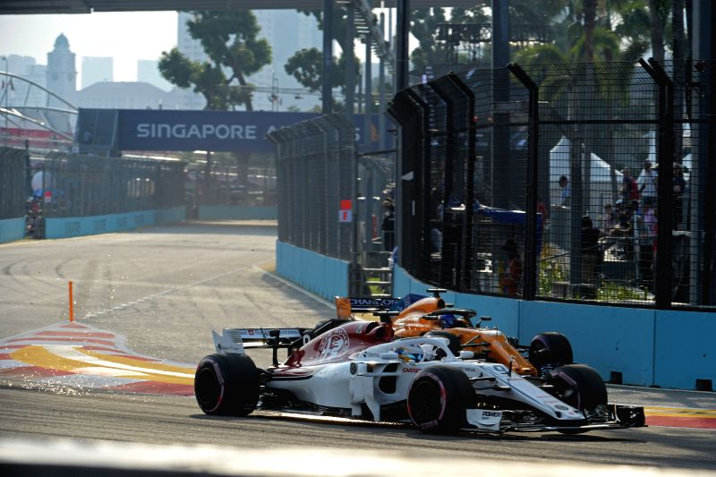 SINGAPORE, Sept. 14, 2018 - Sauber's driver Marcus Ericsson (Front) of Sweden and Mclaren's driver Fernando Alonso of Spain drives in the first practise session of the Formula One Singapore Grand ...