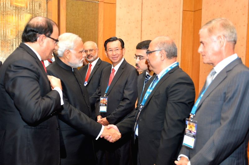 : Singapore: Singapore: Prime Minister Narendra Modi at the `Global Conversation`, an interaction with the Corporate Singapore, at Marina Bay Sands Convention Centre, Singapore on Nov. 24, 2015. ... - Narendra Modi