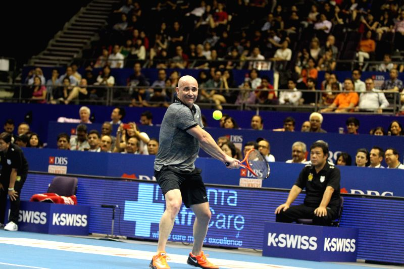 Singapore Slammers' Andre Agassi of the United States hits the ball in the men's singles match with Manila Mavericks' Mark Philippoussis of Australia at the first International Premier ...