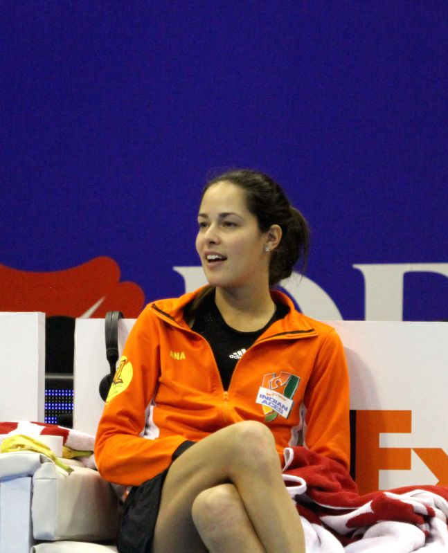 Team Micromax Indian Aces' Ana Ivanovic of Serbia cheers on the side of the court for her teammate in a match of the first International Premier Tennis League (IPTL) in Singapore, Dec. 2, .