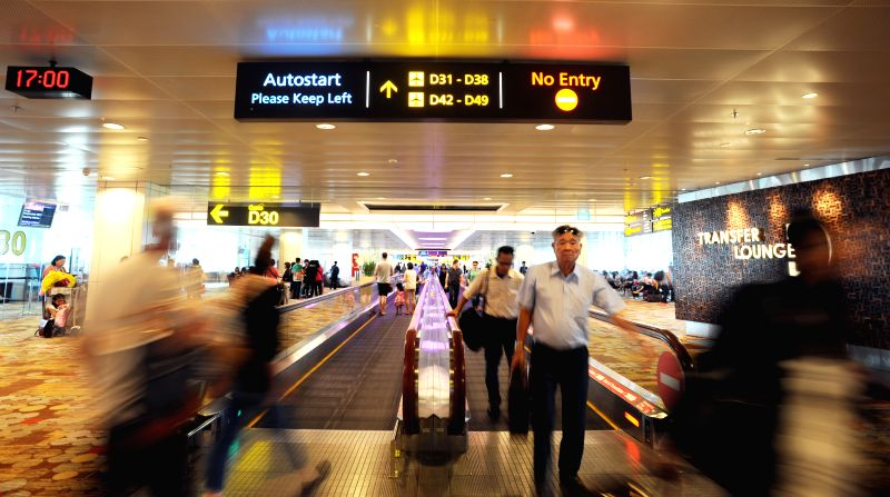 Tourists walk at Terminal 1 at Singapore Changi Airport on Dec. 10, 2014. Passenger traffic at Singapore Changi Airport grew 1.9% in Oct. 2014, with 4.49 million passengers passing through