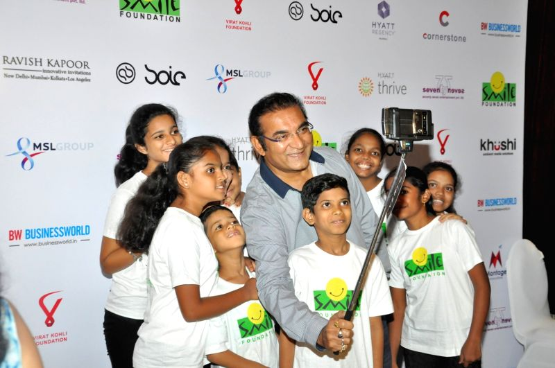 Singer Abhijeet Bhattacharya during the charity dinner hosted by Virat Kohli foundation in association with Smile Foundation, in Mumbai, on June 3, 2016. - Virat Kohli