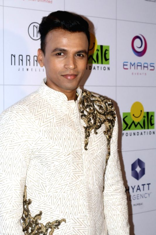 Singer Abhijeet Sawant during the 11th edition of Ramp for Champs organised by NGO Smile Foundation, in Mumbai on Oct 13, 2016.
