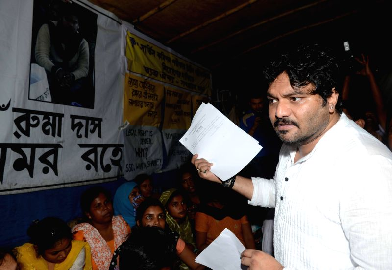 Singer and BJP MP from Asansol Babul Supriyo interacts with SSC qualified person who are sitting on hunger strike at College Square in Kolkata on July 17, 2014.