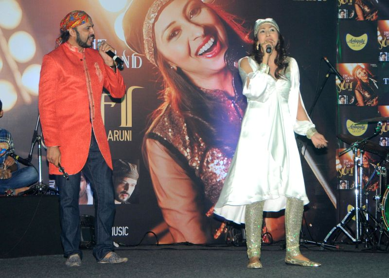 "Singer and Composer Rajeev Mahavir and Singer Aruni Bagga performing during the launch of sufi album ""Sound Of Sufi"" at Hotel Sahara Star in Mumbai on June 18th, 2014"