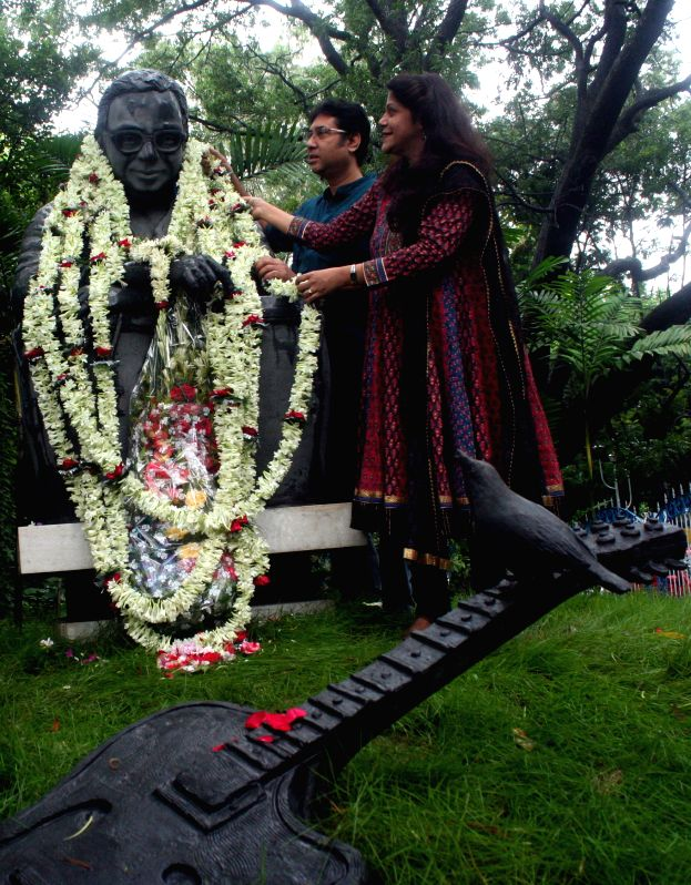 Singer Antara Chowdhury pay tribute to music legend Rahul Dev Burman on his 76th birth anniversary in Kolkata on June 27, 2015.