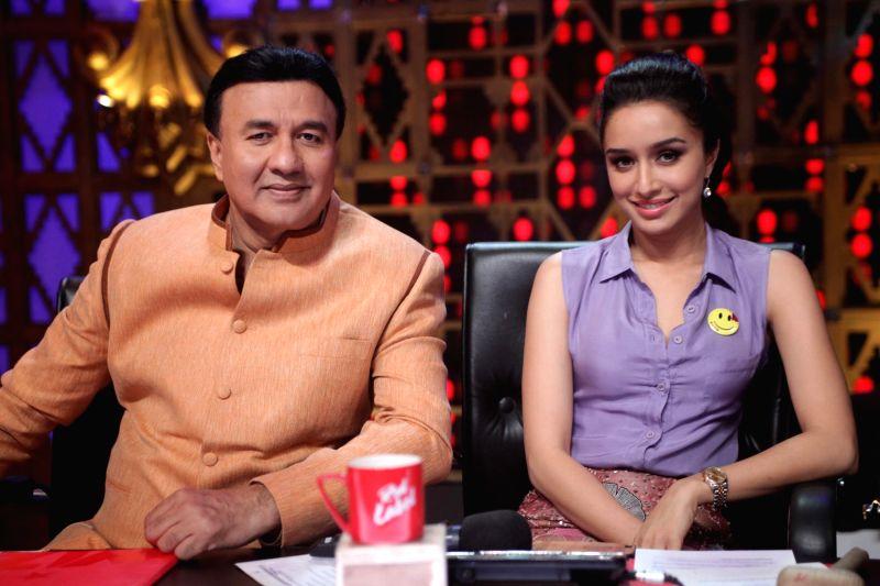 Singer Anu Malik and actor Shraddha Kapoor during the promotion of film Ek Villain on Entertainment Ke Liye Kuch Bhi Karega sets at YRF Studios in Mumbai on June 17th, 2014. - Shraddha Kapoor and Malik