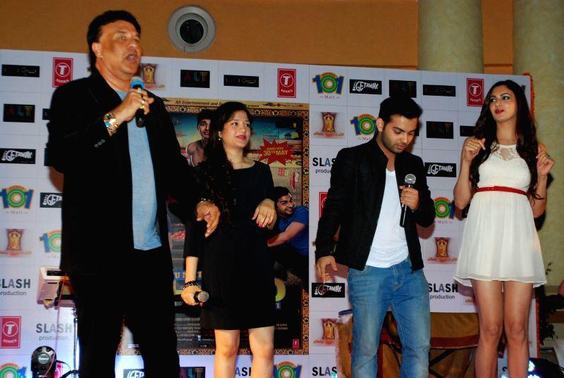 Singer Anu Malik with his daughter Anmol Malik alongwith actors and Ashish Juneja and Mundi Simran Kaur during the promotion of the film Kuku Mathur Ki Jhand Ho Gayi in Mumbai on May 03, 2014. - Malik and Mundi Simran Kaur