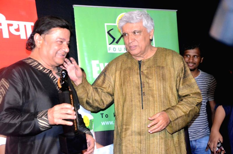 Singer Anup Jalota and lyrcists Javed Akhtar with the Dadasaheb Phalke award trophy in Mumbai on April 21, 2017.