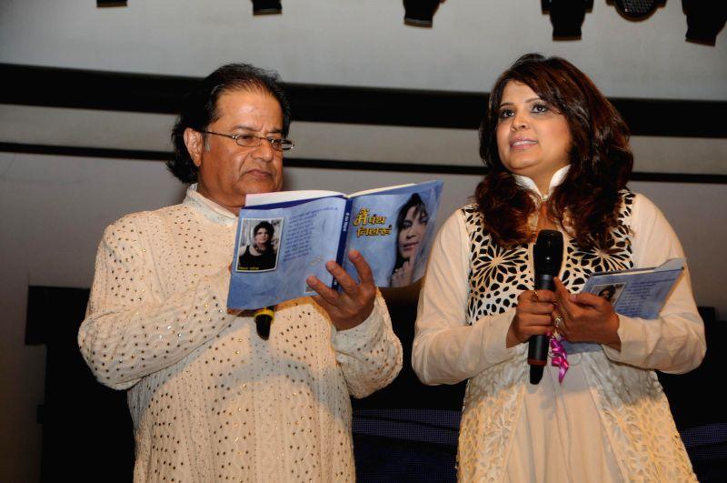 Singer Anup Jalota with Smita Parikh during the Jagjit Singh's brother Kartar Singh's book launch in Mumbai on July 18, 2014. - Jagjit Singh
