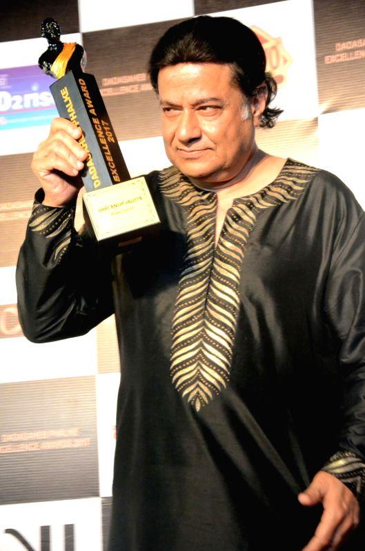 "Singer Anup Jalota with the Dadasaheb Phalke award trophy in Mumbai on April 21, 2017. Anup Jalota was given Dada Saheb Phalke award for ""Bhajan Samrat""."
