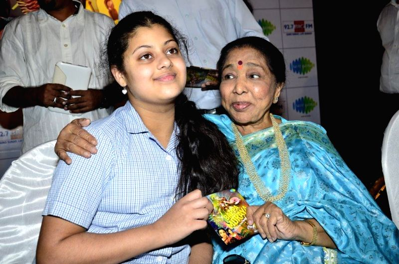 Singer Asha Bhosle during the launch of her new album `Sapne Suhane` in Mumbai on Aug 27, 2014.