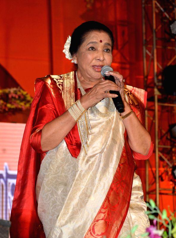 Singer Asha Bhosle performs during a programme in Kolkata on April 15, 2014.