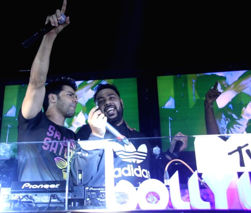 Singer Badshah and actor Varun Dhawan during LIVE Viacom18`s MTV Bollyland Club Nights celebratation Reel life Bachelor party with glamour and oomph in the Mumbai on June 21, 2014. - Varun Dhawan