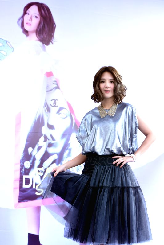 Singer Claire attends an autograph session of her new album in Taipei, southeast China's Taiwan, Nov. 29, 2015.