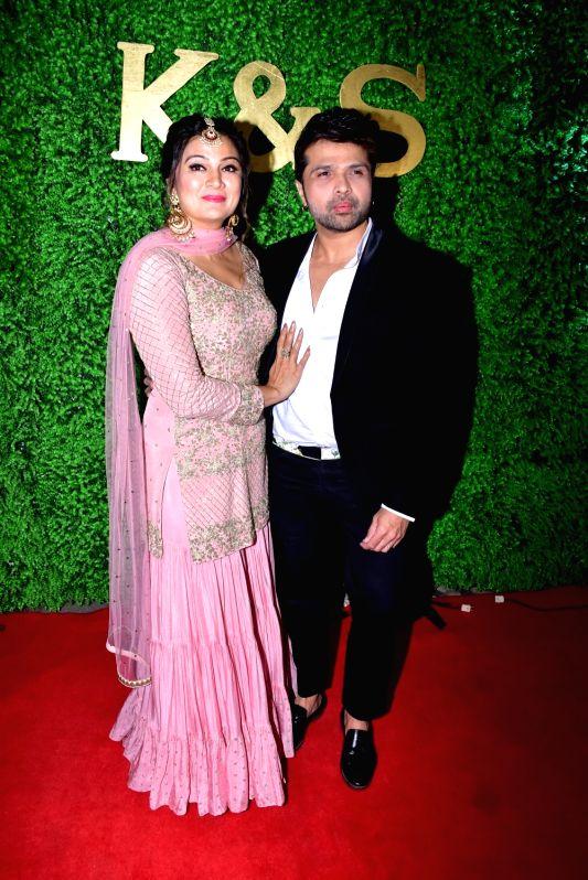 Singer-composer Himesh Reshammiya and his wife Sonia Kapur at the wedding reception of lyricist Sameer Anjaan's daughter Suchita in Mumbai, on Jan 22, 2019.