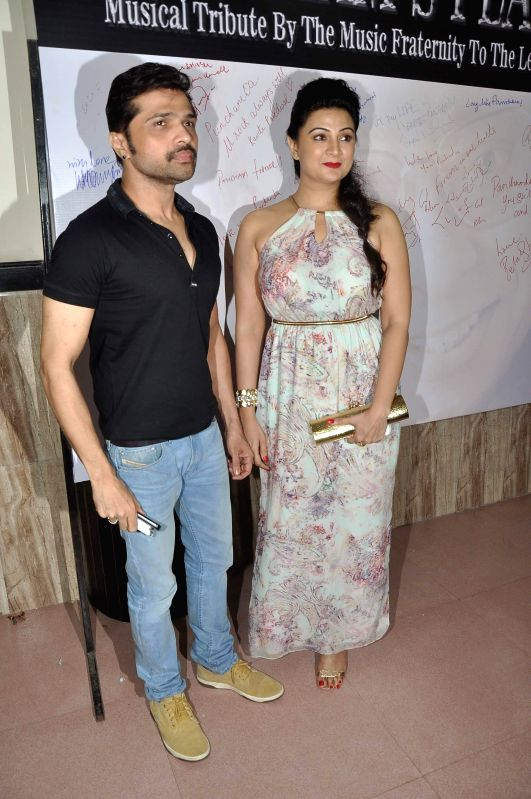 Singer Himesh Reshammiya and TV actress Sonia Kapoor during the celebration of 75th birth anniversary of late music director R D Burman in Mumbai, on June 27, 2014. - Sonia Kapoor