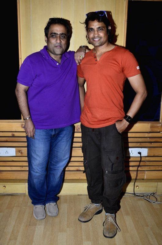 Singer Kunal Ganjawala and actor Siddath Jaaju during the records song for the film  ``Auto Romance `` in Mumbai  on 22nd April 2014. - Siddath Jaaju