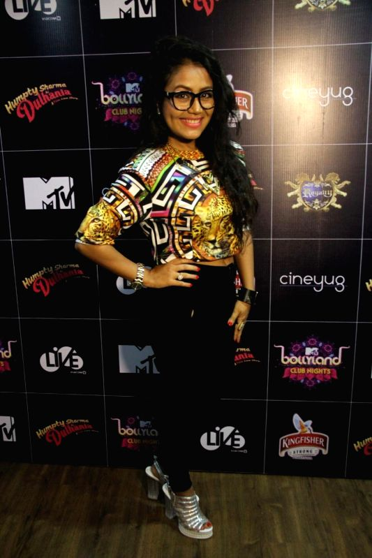 Singer Neha Kakkar during LIVE Viacom18`s MTV Bollyland Club Nights celebratation Reel life Bachelor party with glamour and oomph in the Mumbai on June 21, 2014.