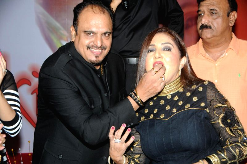 Singer Nikita H Chandiramani, with Mr. Chandiramani during the music release of album Kiran, in Mumbai, on Aug 18, 2014.