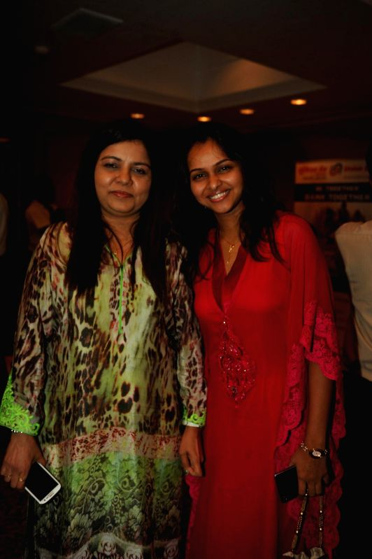 Singer Sadhana Sargam and ghazal singer Pooja Gaitonde during a press conference organised to announce `The Festival of Ghazal` in Mumbai on July 23, 2014.