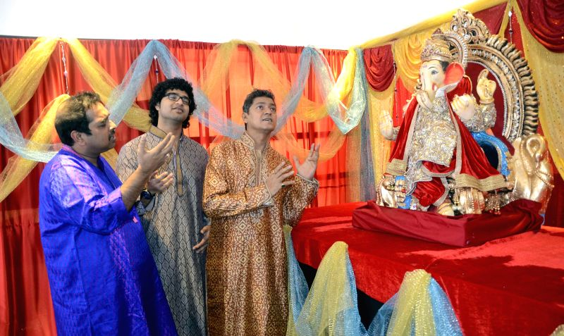 Singer Shankar Mahadevan, his son Siddharth Mahadevan and singer Aadesh Shrivastava celebrate Ganesh Festival in Mumbai on Aug 29, 2014.