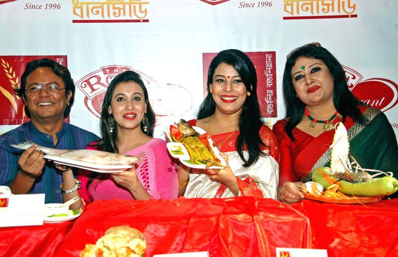 Singer Sidhu, actress Sayani Dutta, Anindita Banerjee Roy and singer Ridhi Bandopadhyay (L to R) at the launch of a Bengali restaurant in Kolkata on Sept 3, 2014. - Sayani Dutta and Anindita Banerjee Roy